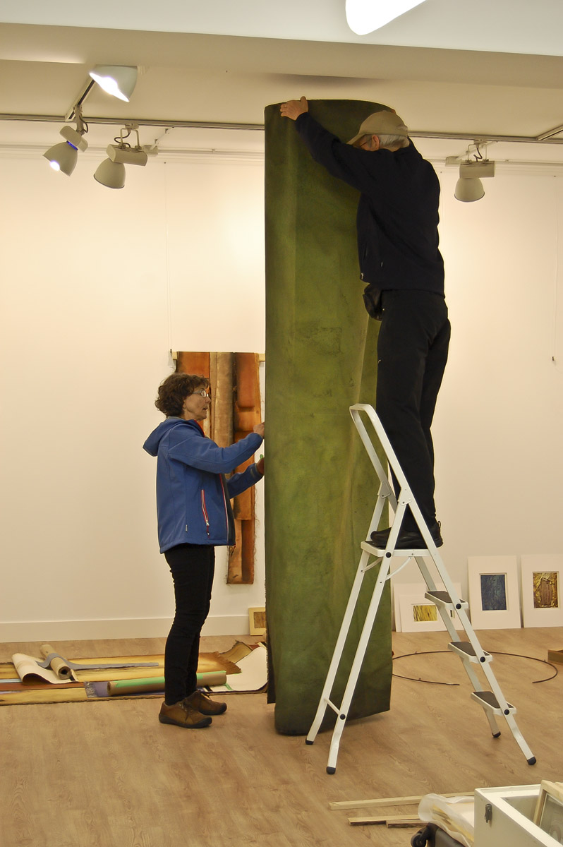 "Bill & Claire hanging the central fabric column of her piece ""Grove"". Garikoitz Murua Fierro photo."
