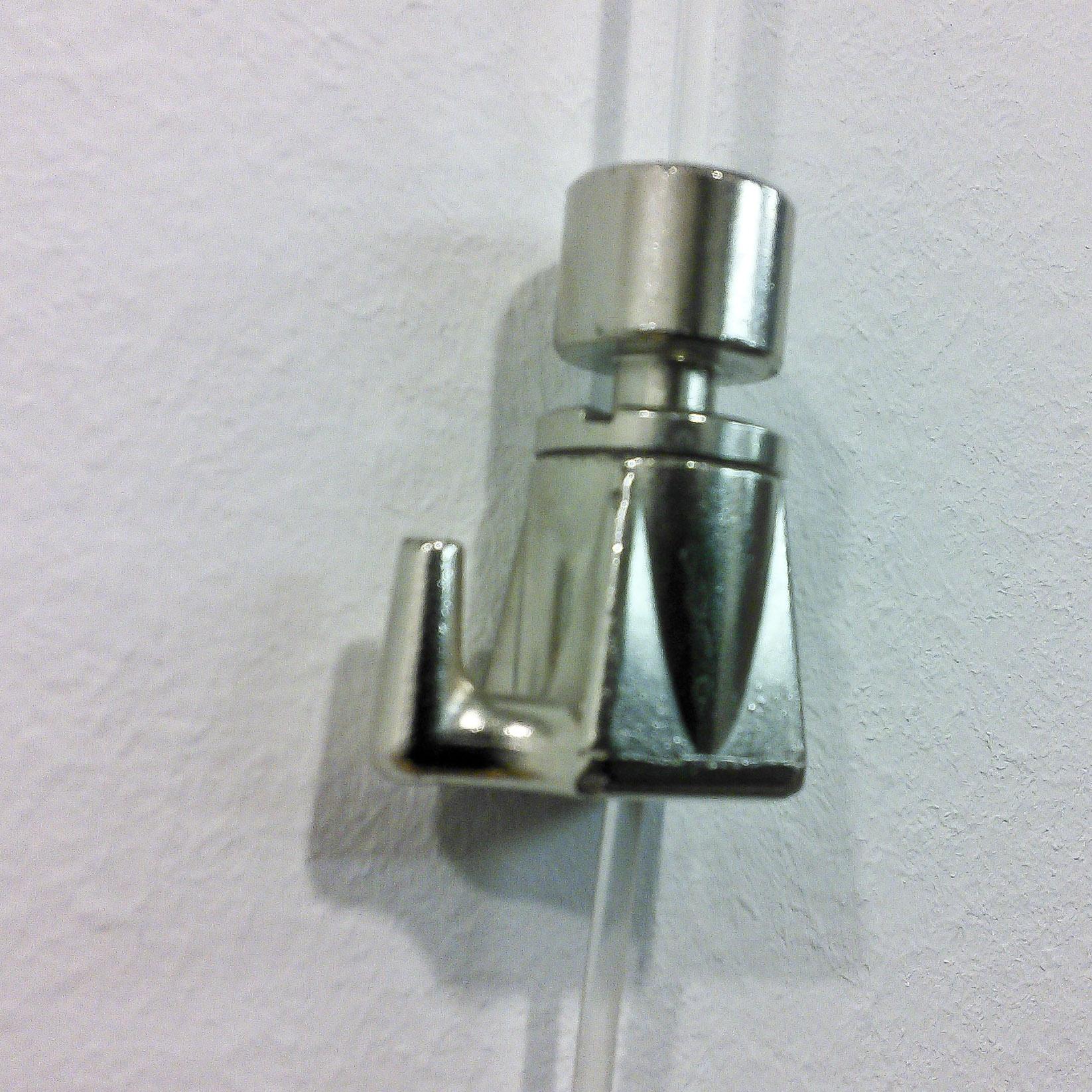 Hanging system: closeup of sliding metal hardware.